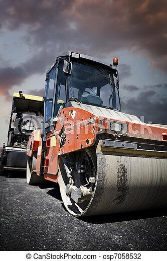 Heavy Vibration roller at asphalt pavement works (road repairing) - csp7058532