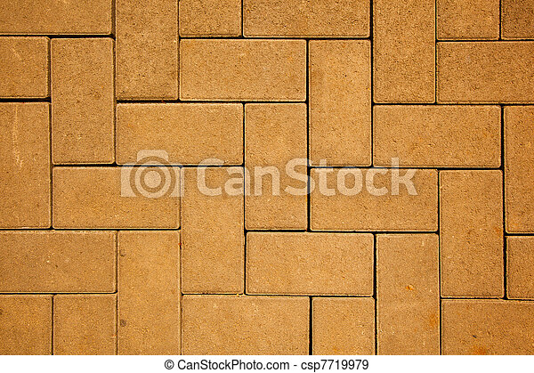 Patrón de pavimento hecho con bloques de hormigón en color amarillo - csp7719979