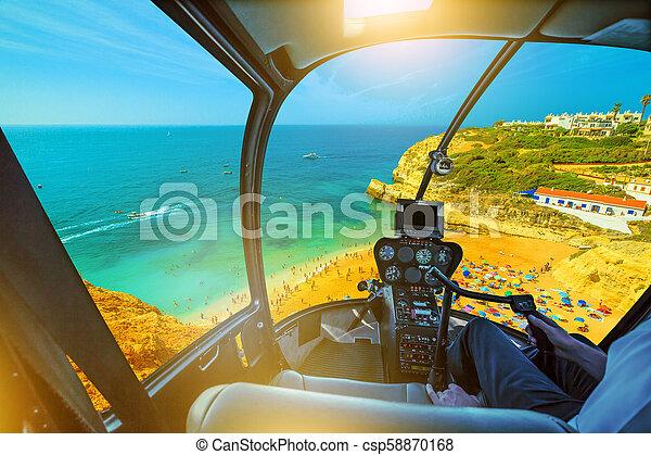 Helicopter on Benagil Beach - csp58870168