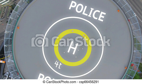 Helipad in the police station on the roof of the house - csp66456291