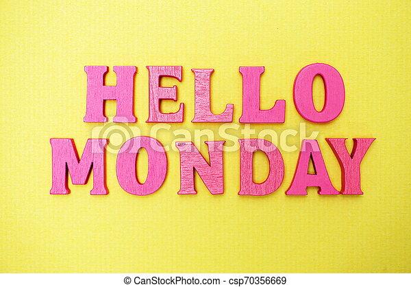 Hello Monday alphabet letters on yellow background - csp70356669