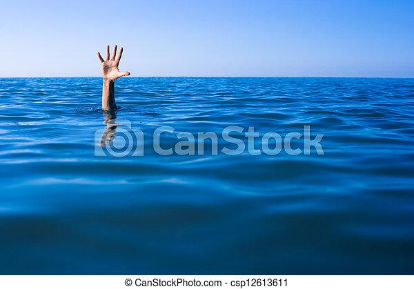 Help needed. Drowning man's hand in sea or ocean. - csp12613611