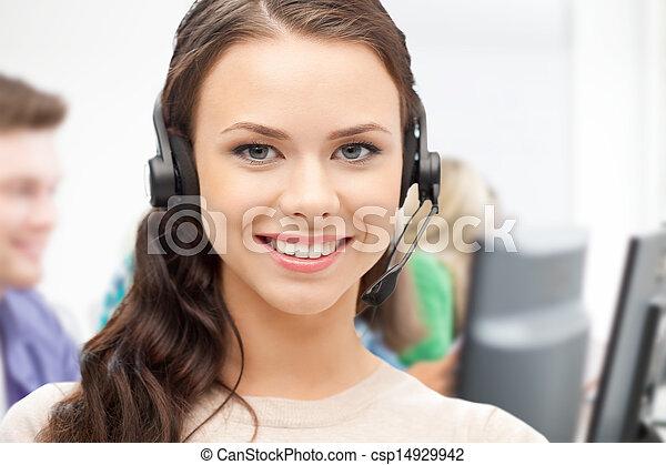 helpline operator with headphones in call centre - csp14929942