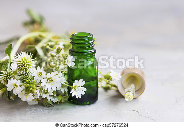 Herbal And Aromatherapy Essential Oil With White Flowers And