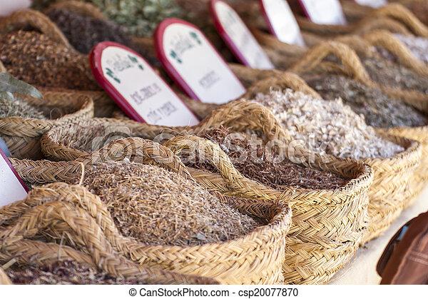 Herbal, wicker baskets stuffed medicinal healing herbs - csp20077870