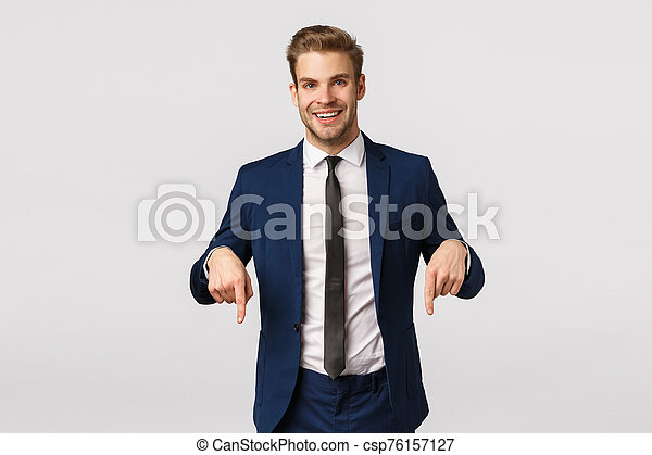 Here is what you need. Handsome stylish happy businessman, blond bearded guy in classic suit, invite check out promo, pointing fingers down and smiling, have interesting corporate banner for you see - csp76157127