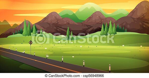 Camino campestre con una hermosa escena de montaña - csp56948966
