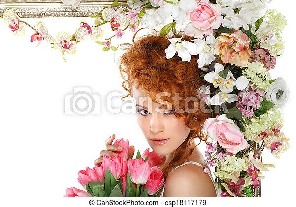 Hermosa chica pelirroja con el ramo de tulipanes, que está en un marco de oro, florecida, aislada en un fondo blanco - csp18117179