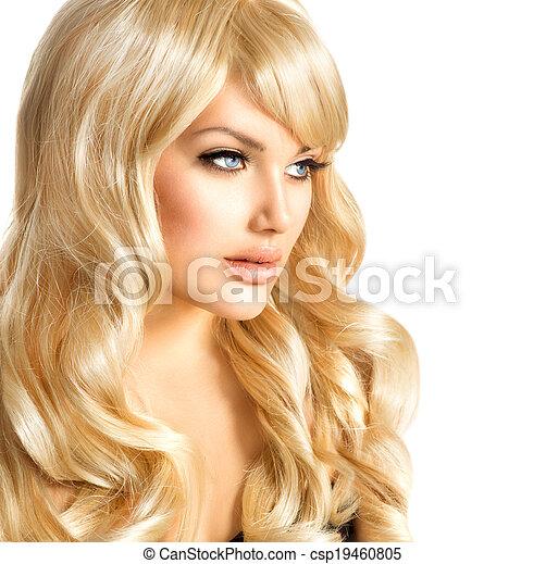 Mujer rubia hermosa. Hermosa chica con el pelo largo y rubio rizado - csp19460805