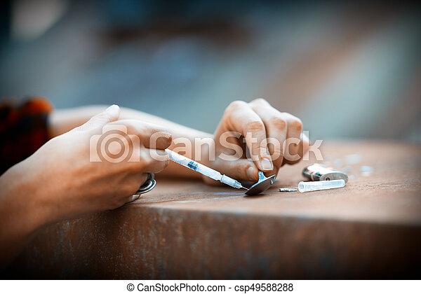 Heroin drug preparation with lighter - csp49588288