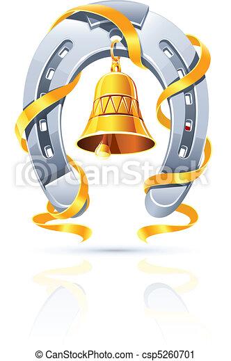 Una herradura metálica con campana de oro y cinta - csp5260701