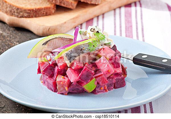Herring salad with sour cream sauce - csp18510114
