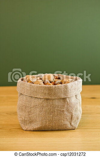 Hessian sack full of nuts - csp12031272