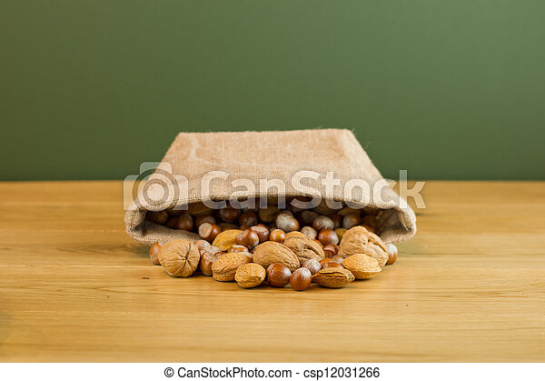 Hessian sack with mixed nuts spilling out - csp12031266