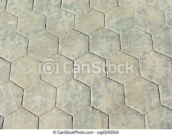 hexagon footpath - csp0243504 & Hexagon footpath. Polygonal concrete tiles used on sidewalk.