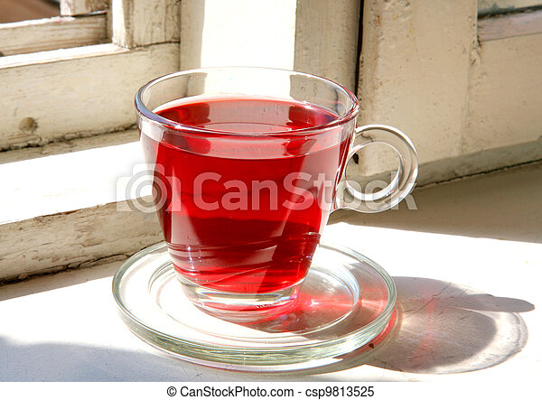 Hibiscus flower red tea on an old window-sill - csp9813525
