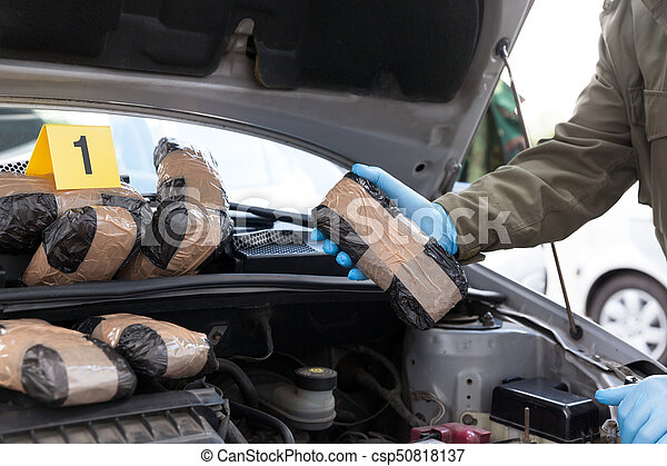 Hidden drugs in a vehicle secret compartment