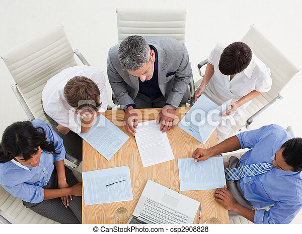 High angle of a joyful business team with thumbs up in a meeting - csp2908828