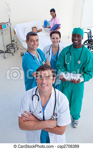 High angle of doctor, surgeon and nurse with a child patient - csp2706389