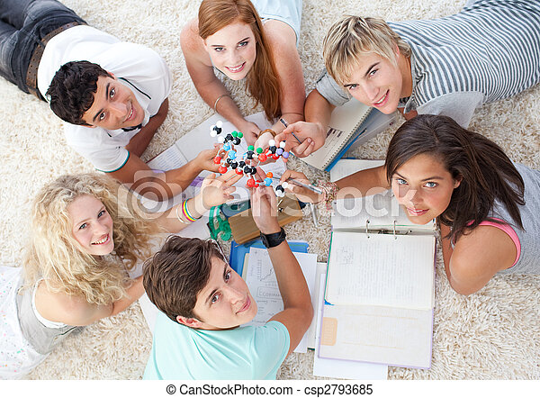 High angle of teenagers studying Science on the floor - csp2793685