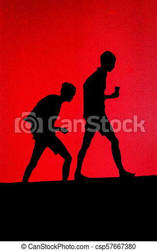 High contrast relief of two boys walking on hill - csp57667380