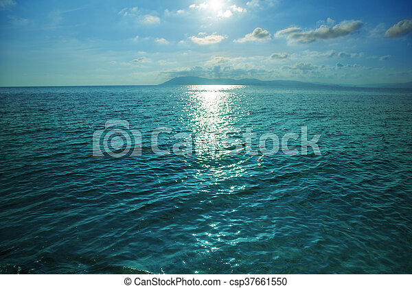 High contrast sea or ocean surface texture at sunset. - csp37661550