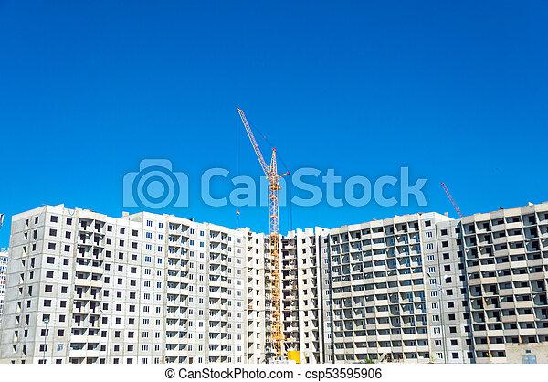 High crane and new multi-storey building - csp53595906