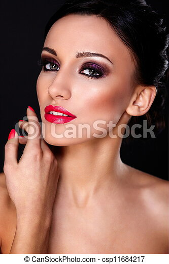 High fashion look.glamor closeup portrait of beautiful sexy Caucasian young woman model with red lips,bright makeup, with perfect clean skin isolated on black  - csp11684217
