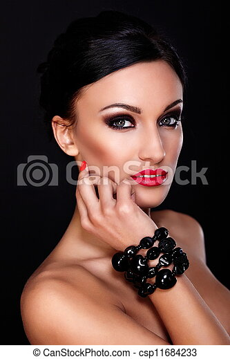 High fashion look.glamor closeup portrait of beautiful sexy Caucasian young woman model with red lips,bright makeup, with perfect clean skin isolated on black  - csp11684233