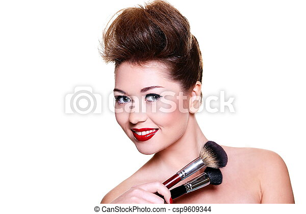 High fashion look.glamour close-up portrait of sexy smiling brunette caucasian young female woman with bright make-up with red lips and red bright manicure with makeup brushes - csp9609344