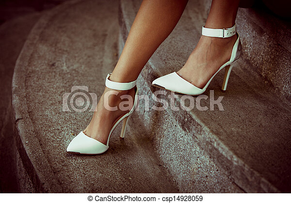 outlet on sale best sell outlet store sale Woman legs in elegant white high heel shoes outdoor shot summer day.