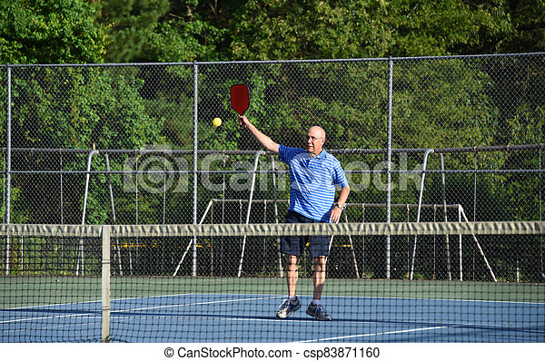 High Hit in Pickle Ball - csp83871160