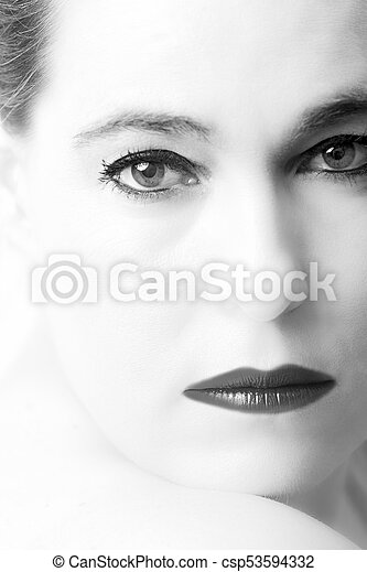 High key portrait of a woman with empty expression on her face - csp53594332
