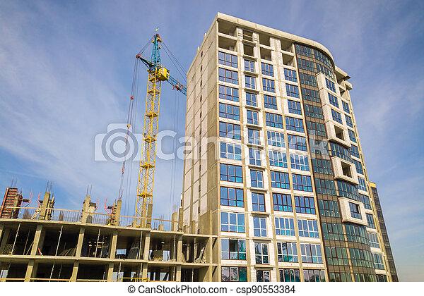 High residential apartment building under construction. Real estate development. - csp90553384