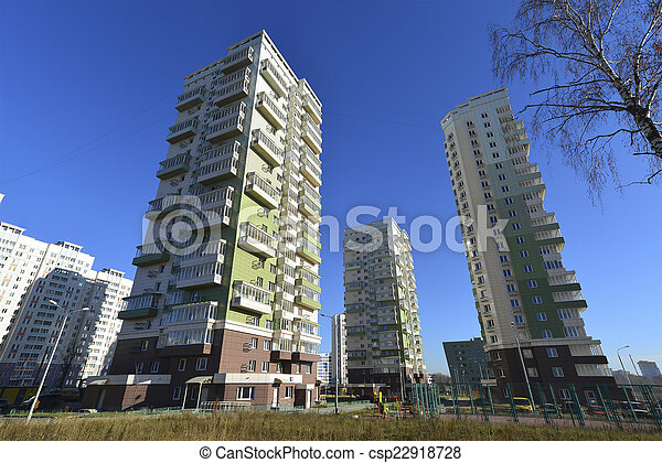 High residential buildings on the background of blue sky - csp22918728
