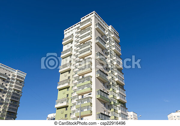 High residential buildings on the background of blue sky - csp22916496