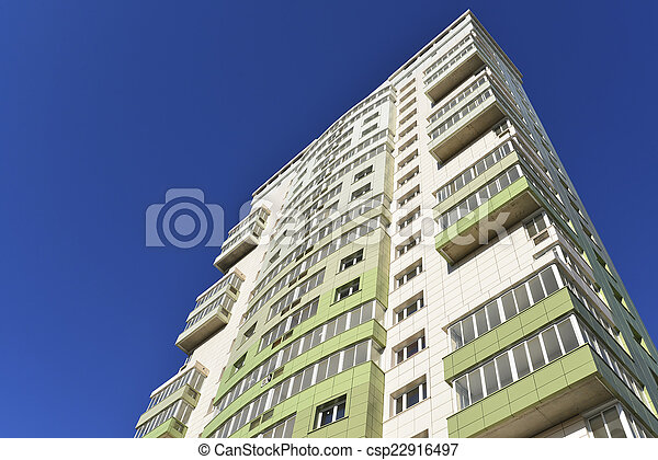 High residential buildings on the background of blue sky - csp22916497