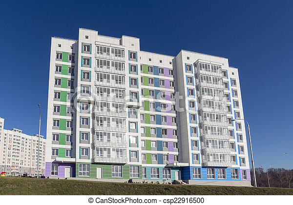 High residential buildings on the background of blue sky - csp22916500