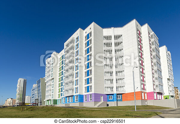 High residential buildings on the background of blue sky - csp22916501