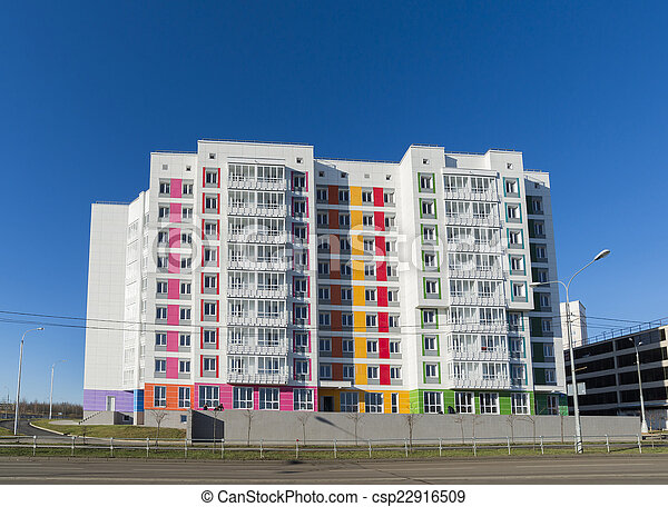 High residential buildings on the background of blue sky - csp22916509