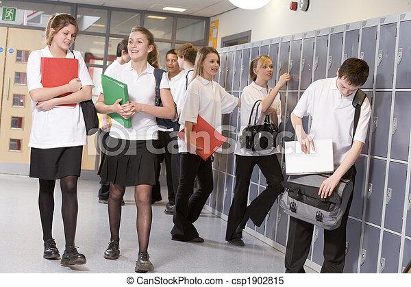 High school students by lockers in the school corridor - csp1902815