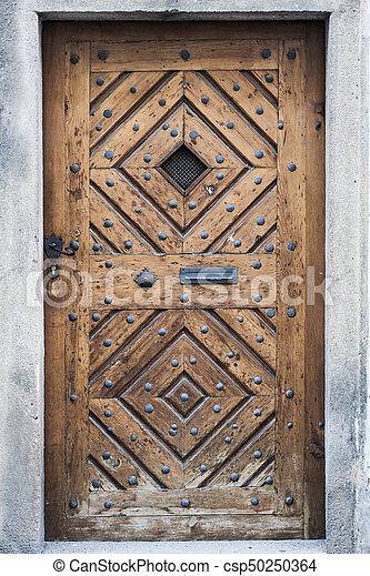 High textured medieval wood door - csp50250364 & High textured medieval wood door with black metal nails... stock ...