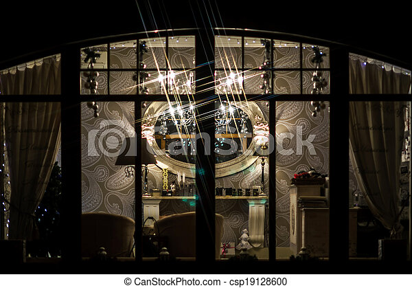 Highlighted interior in shop window - csp19128600