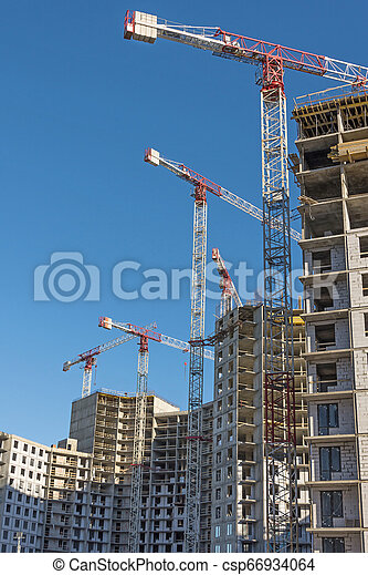 Hight construction cranes, large-scale construction of a residential complex - csp66934064
