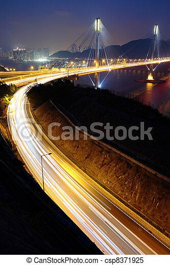 highway and Ting Kau bridge at night - csp8371925
