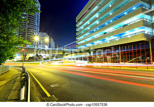 Highway at night in modern city - csp10557536