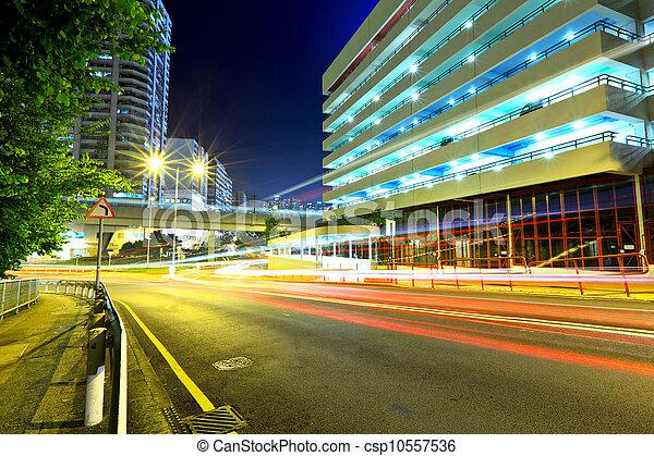 Highway at night in modern city - csp10557536