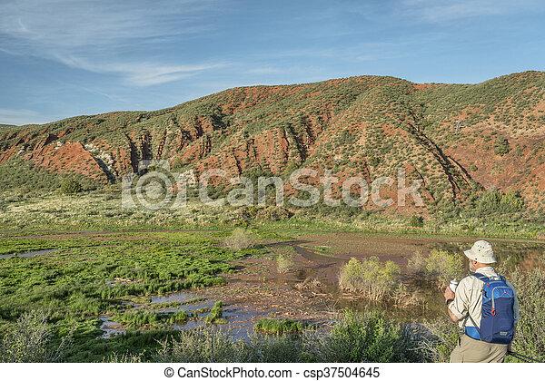 hiker at Colorado foothills - csp37504645