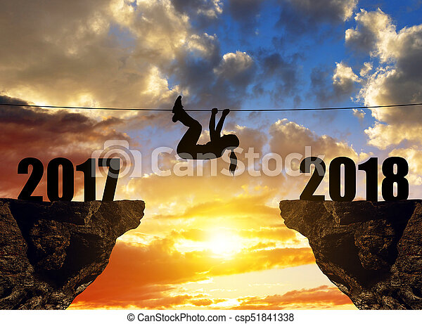 Hiker climbs into the New Year 2018. - csp51841338