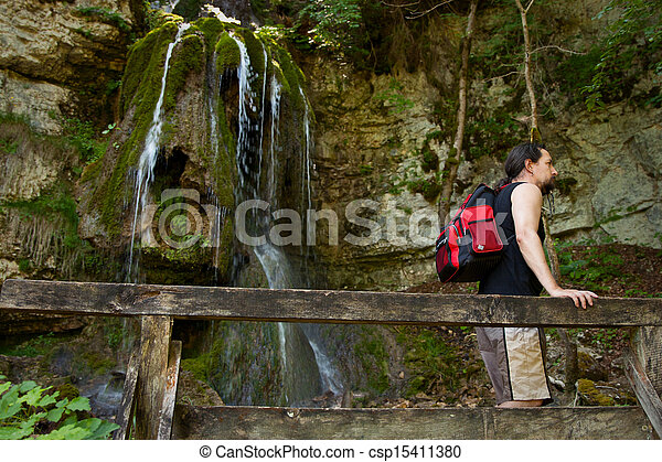 Hiker in a canyon - csp15411380